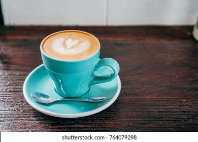 Cup of coffee on a wooden table.Blue Mug  coffee .