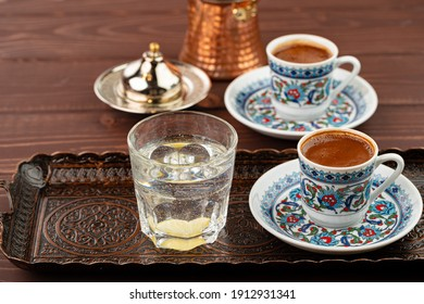 Cup of coffee in oriental style on metal tray