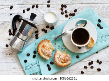 Cup of coffee with pasticciotto pastry on a rustic background top view