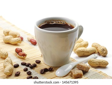 Cup of coffee and peanuts