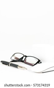 cup of coffee, pen, mouse and glasses, on a white background