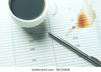 cup of coffee and pen on document