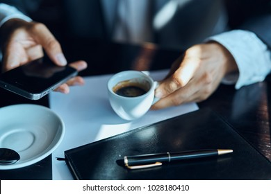 cup of coffee, phone, documents, business
