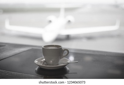 A cup of coffee placed on table in airport