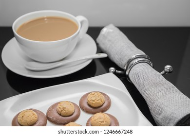 Cup of coffee and plate of amaretti cookies