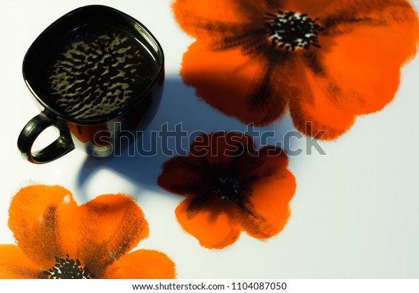 A cup of coffee and poppies