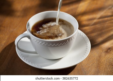 Cup of Coffee with Pouring Creamer