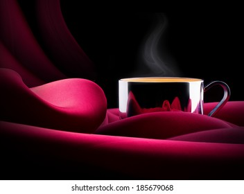 cup of Coffee  with red silk. Vintage background