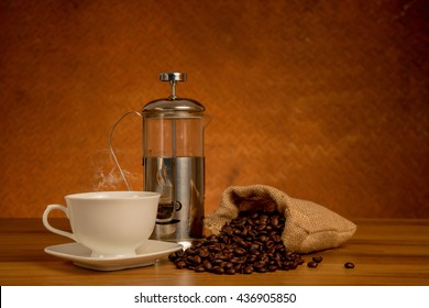 cup of coffee and roasted beans with pot,still life