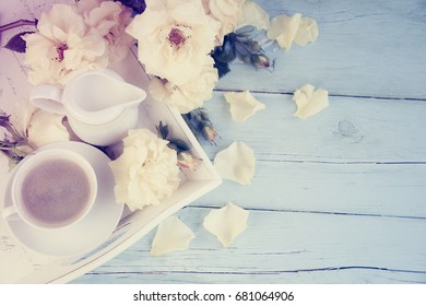 Cup of coffee and rose flowers.