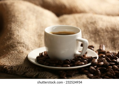 Cup of coffee with sackcloth on table