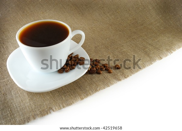 Cup of coffee with seed on the sack background