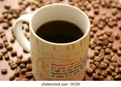 Cup of coffee set against a backdrop of coffee beans. Shallow DOF.