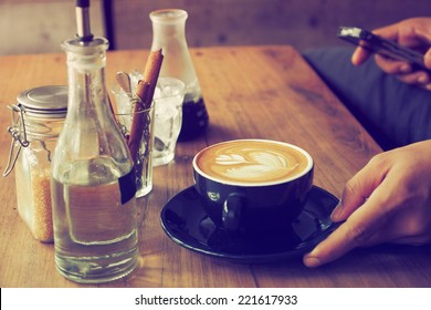 cup of coffee in coffee shop vintage color