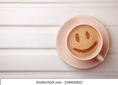 Cup of coffee with smile face on foam. I like coffee break. Good mood.