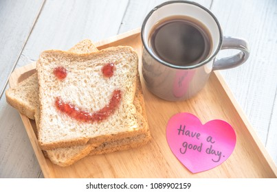 Cup Of Coffee And Smiling Face Toast Of Jam With Notes Have A Good Day On Table From Above. Pleasant Surprise A Friend Or Loved One.