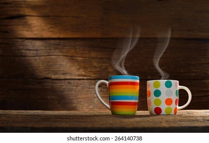 Cup of coffee with smoke on old wooden background,This photo is available without smoke