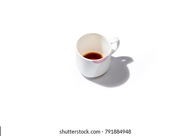 a cup of coffee soiled by lipstick left as a symbol of affection and relationship on a white background and shadow