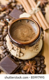 cup of coffee with spices and chocolate