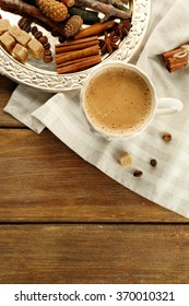 Cup of coffee and spices on metal tray on napkin