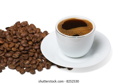 Cup of coffee and spilled out coffee beans on white background.