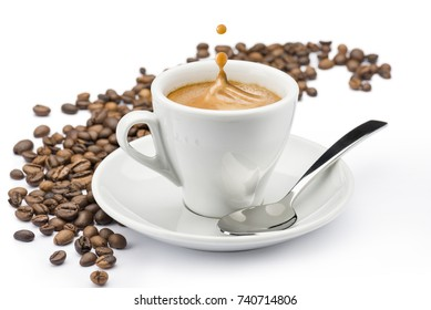cup of coffee with splashing and beans on white background