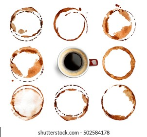 Cup of coffee and stains on white background