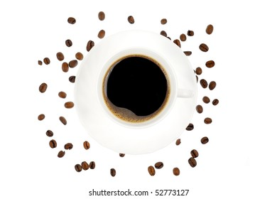 Cup of coffee surrounded by beans - isolated on white background