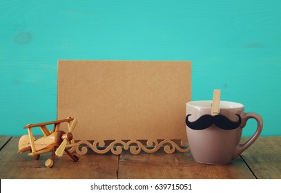 Cup of coffee with toy plane on wooden table. Father's day concept - Shutterstock ID 639715051