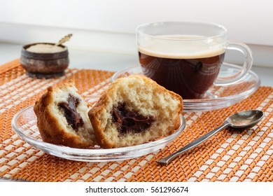 Cup of coffee, two halves  cake with stuffing and a spoon