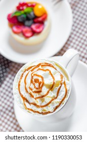 a cup of coffee with whipped cream and dipping