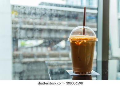 A cup of cold coffee in rainy day.Selective focus.