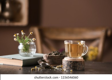 Cup of delicious chamomile tea on table