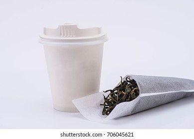 A cup of disposable cardboard for tea, white, on a white background, isolated, with tea