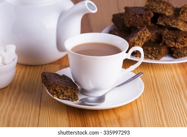 Cup of English Tea with Cake for Tea Break in Afternoon with silver spoon and bowl of sugar cubes