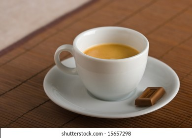 Cup of espresso coffee and delicious milk chocolate