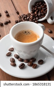 Cup of espresso coffee on wood background - Shutterstock ID 1865318131