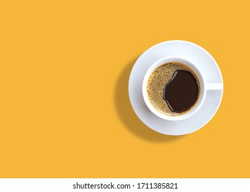 cup of espresso coffee on yellow background. Zenith