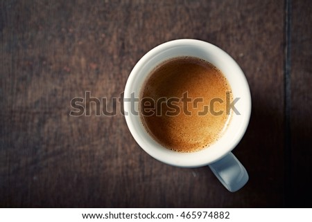 Cup of Espresso on rustic wooden background. Top view. Copy space.