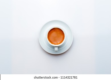 A cup of espresso on a white background