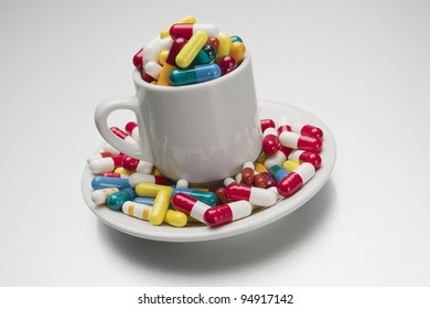 cup filled to overflowing with medical capsules