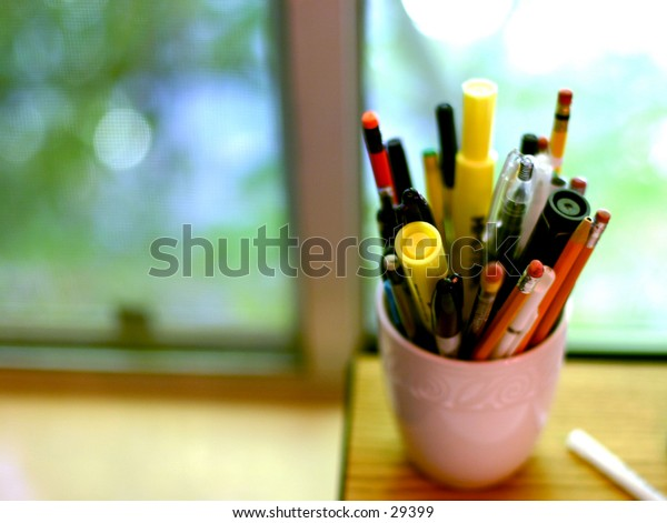 cup fool of pens and pencils
