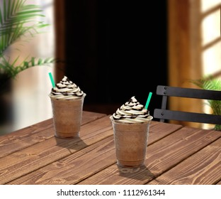 Cup of frappuccino to go on wooden table at cafe. Frappuccino in takeaway cup on table.