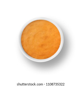 cup of french dressing isolated on a white background