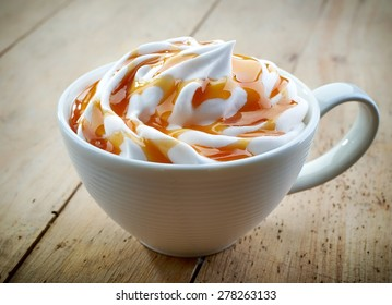 cup of a fresh caramel latte with whipped cream