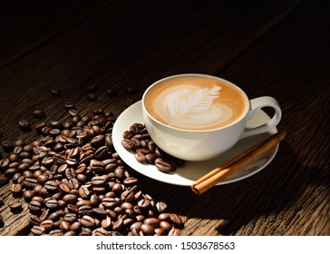 Cup of fresh coffee with coffee beans