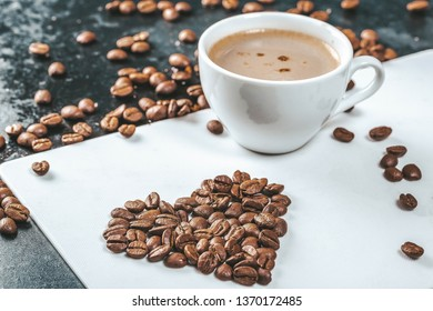 A Cup of fresh coffee with coffee beans on the table