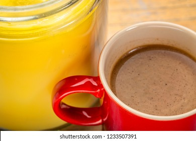 cup of fresh fatty coffee with ghee (clarified butter) - ketogenic diet concept