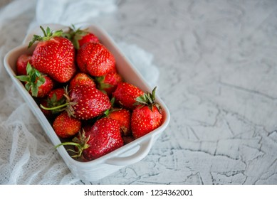 A Cup with fresh ripe strawberries.