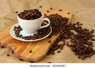 A cup full of coffee beans